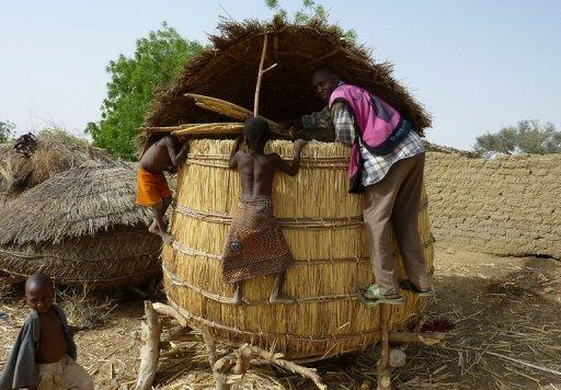 Children from the Tarna village climb on a grain silo in southern Niger in 2010